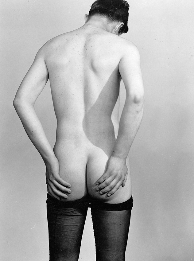 Back view of standing figure, nude except for stockings, Anonymous photograph from the Kinsey Institute Documentary Collection © The Kinsey Institute