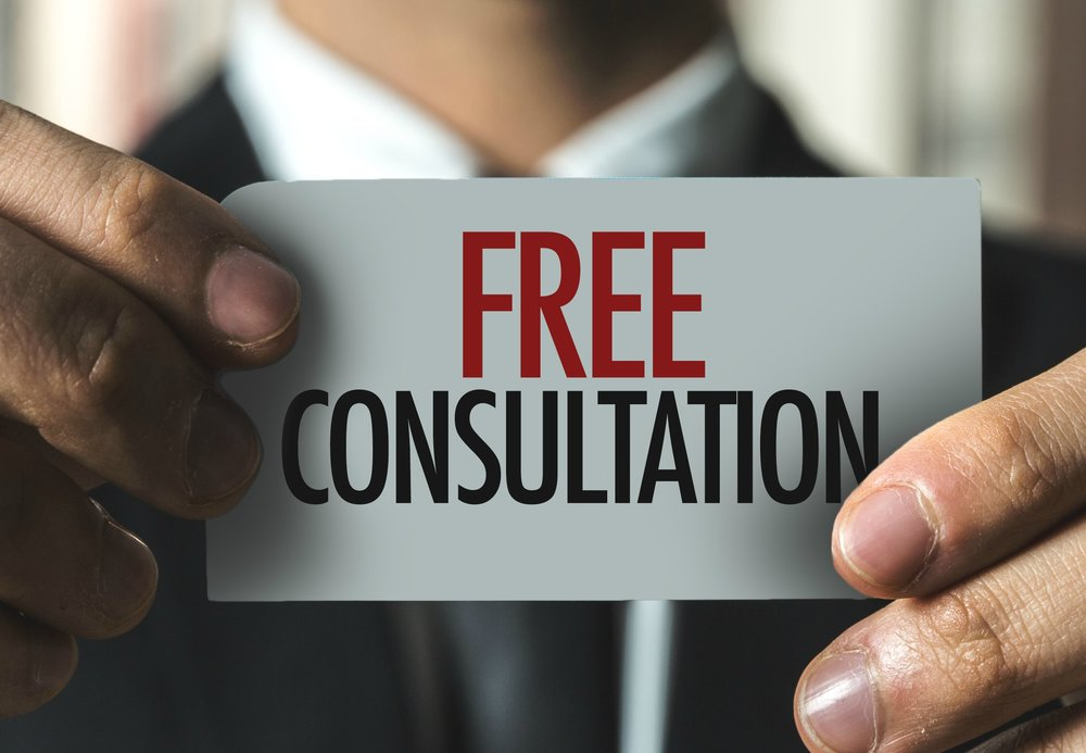 Man holding up a card saying free consultation