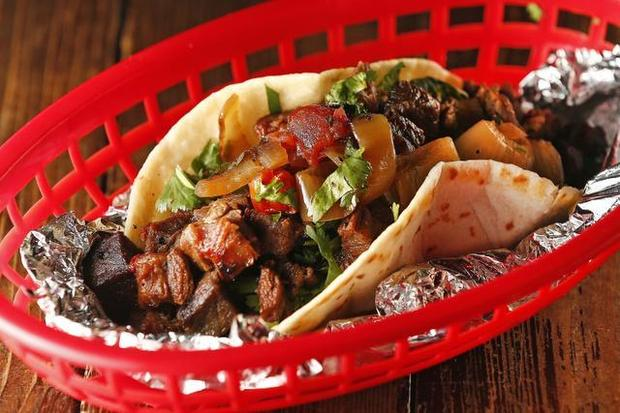 "DEL NORTE TACOS Home: 101 E. Hwy 171, Godley, TX Owner & Pitmaster: Chris Garcia With mesquite-smoked meats infused into signature Mexican dishes, chef Chris Garcia has created a Tex-Mex BBQ destination in the small town of Godley, Texas. Chris originally converted a small 1927 gas station into a taco stand with a single pit, but thanks to rave reviews from countless food critics, Del Norte now attracts crowds from all over Texas. Del Norte patrons come to experience a laid-back patio atmosphere and what Texas Monthly called the ""most colorful presentation of smoked meat found in the state."" Read More: https://www.yelp.com/biz/del-norte-tacos-godley"