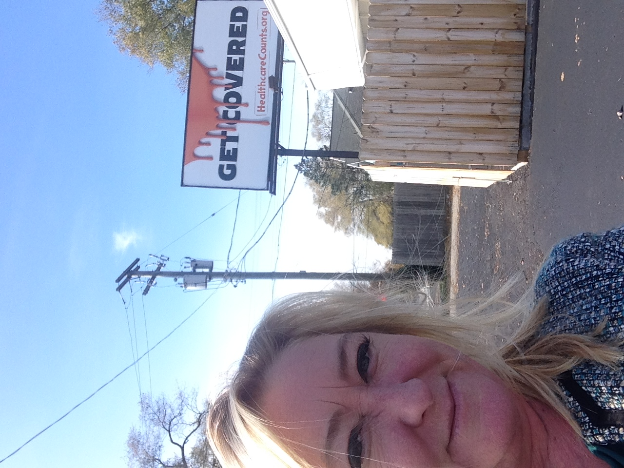 Jean with a selfie of our billboard campaign.