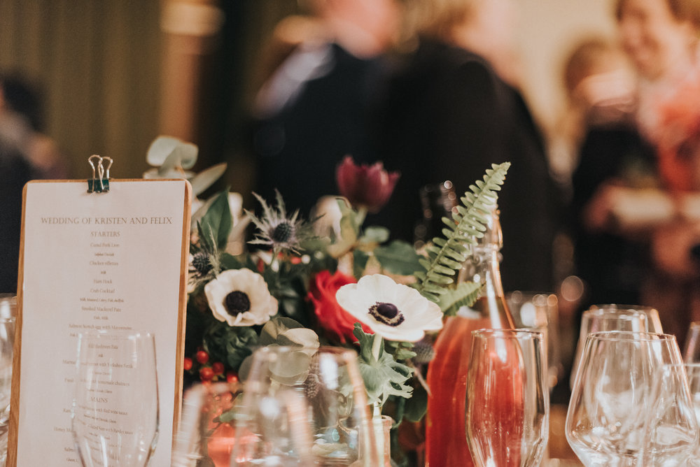 Gold compote centrepieces with anenomes, ranunuculus, ferns and astilbe- Photo by Jay Tunbridge