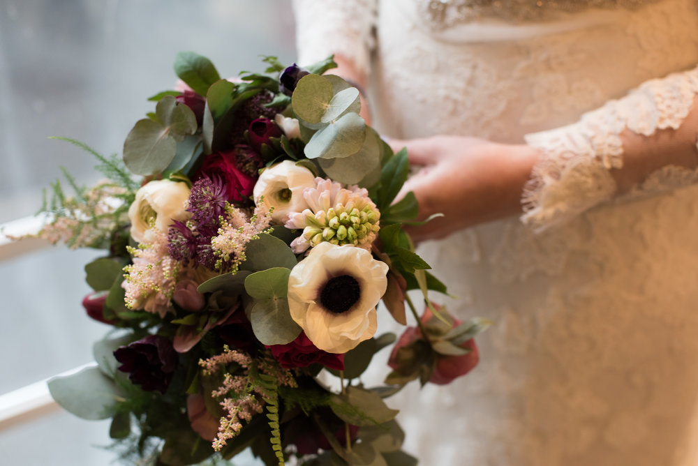 Trailing bouquet with anemones, ranunculus, hyacinths, astilbe ferns and eucalyptus- photo by Jay Tunbridge