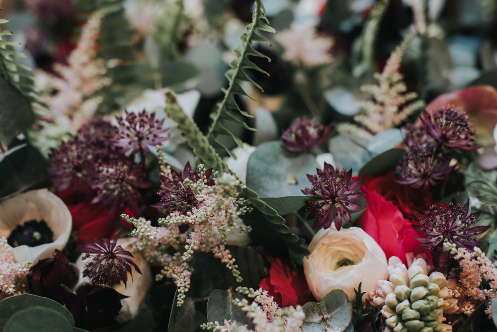 Bridesmaids bouquets with anenomes, ranunculus, hyacinths, astilbe ferns and eucalyptus- photo by Jay Tunbridge