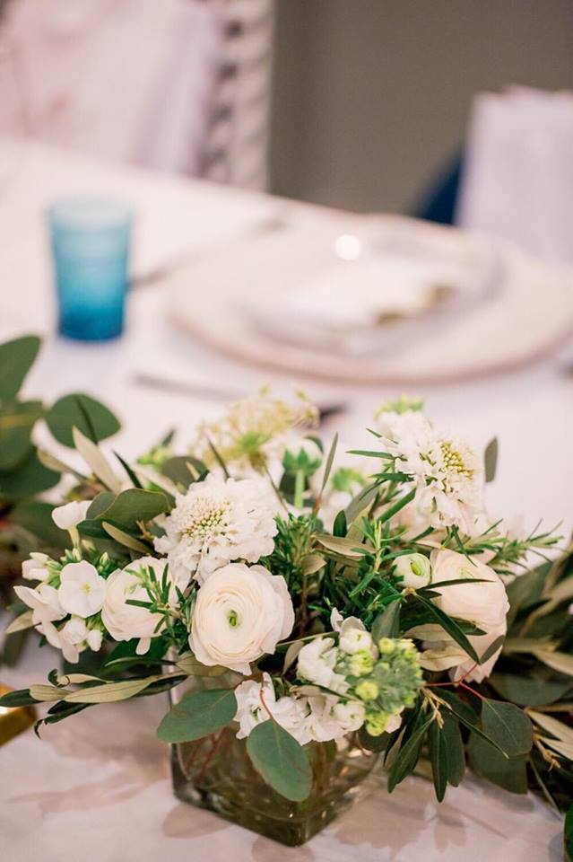 simple white and green arrangements for event.jpeg