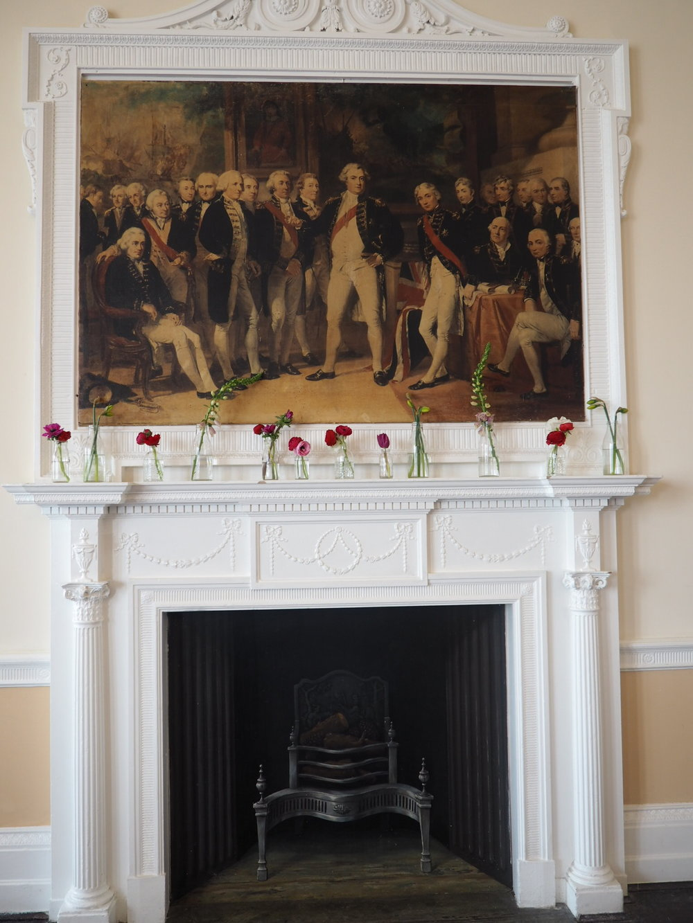 trafalgar tavern greenwich fireplace with flowers in bottles