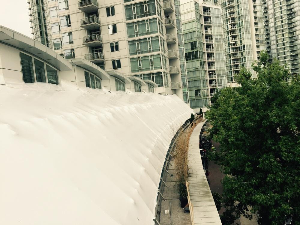 Directly below are open patios for restaurants below construction area.