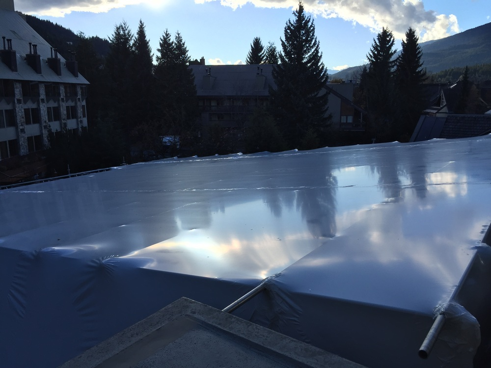 Rhino Wrap has mastered Shrinking flat roofs from ontop instead of below.