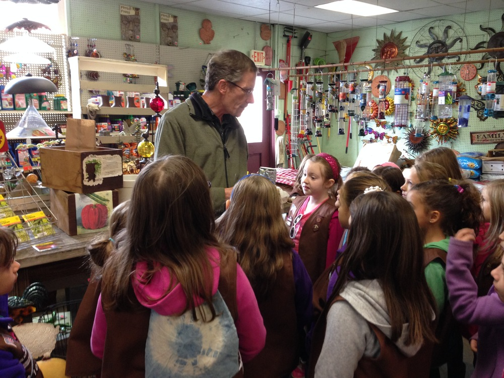 Bill Karges will help gardeners of any age!  Here he gives some Pioneer history to a local Girl Scout troop.