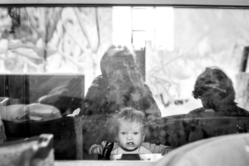 Molly Rees Photo - Black and White Documentary Childhood Photography - Portrait of boy looking out window by M. Menschel