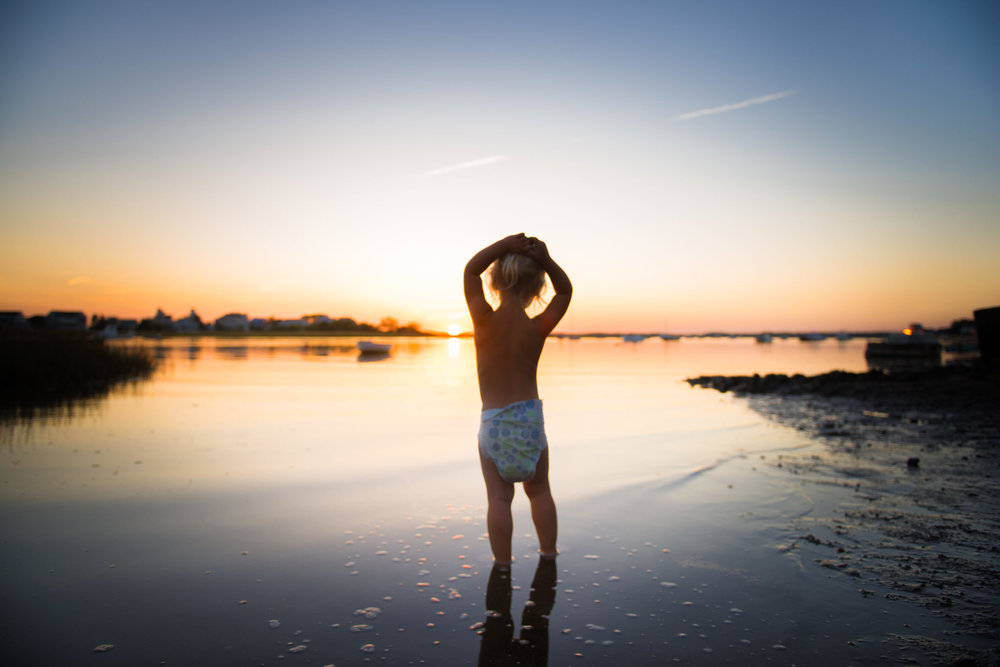 Molly Rees Photo - Documentary Childhood Photography - Portrait of girl in the basin at dusk, sunset silhouette on Plum Island in Newburyport, Massachusetts by M. Menschel