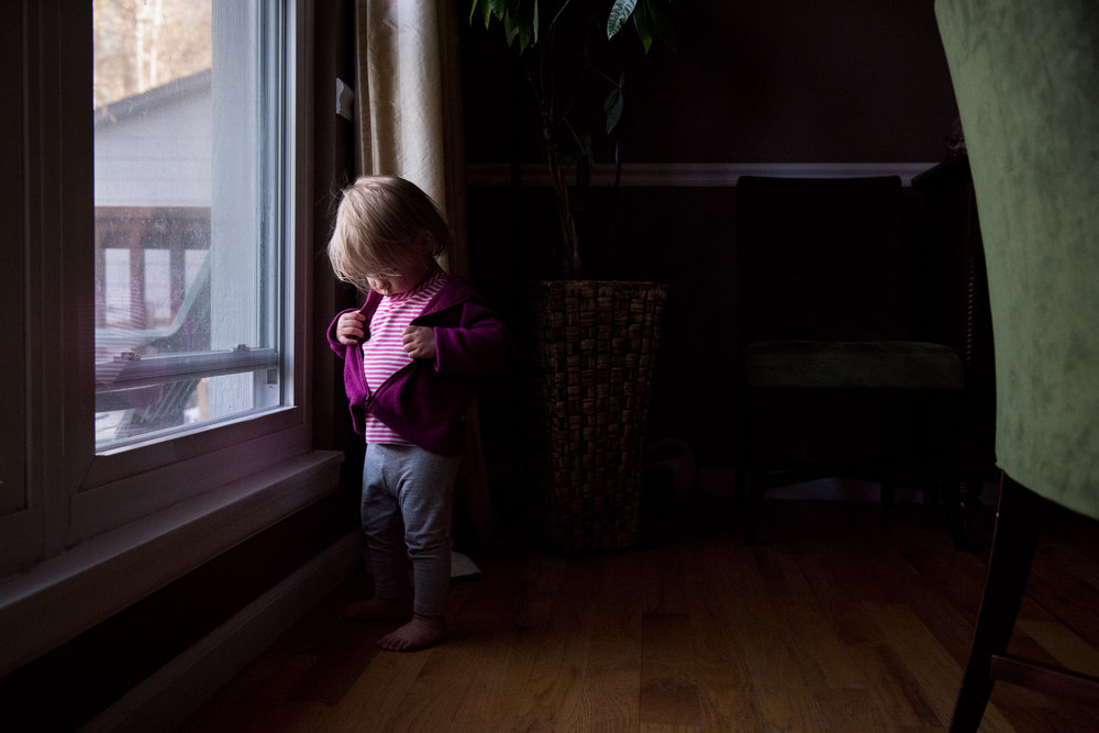 Documentary Family Photography in Denver, Colorado - girl by window