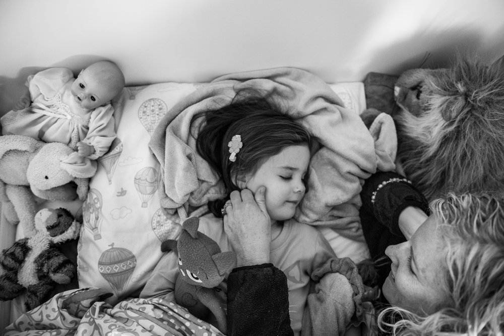 Molly Rees Photo - Black and White Documentary Family Photography in Denver, Colorado - mom putting girl to bed