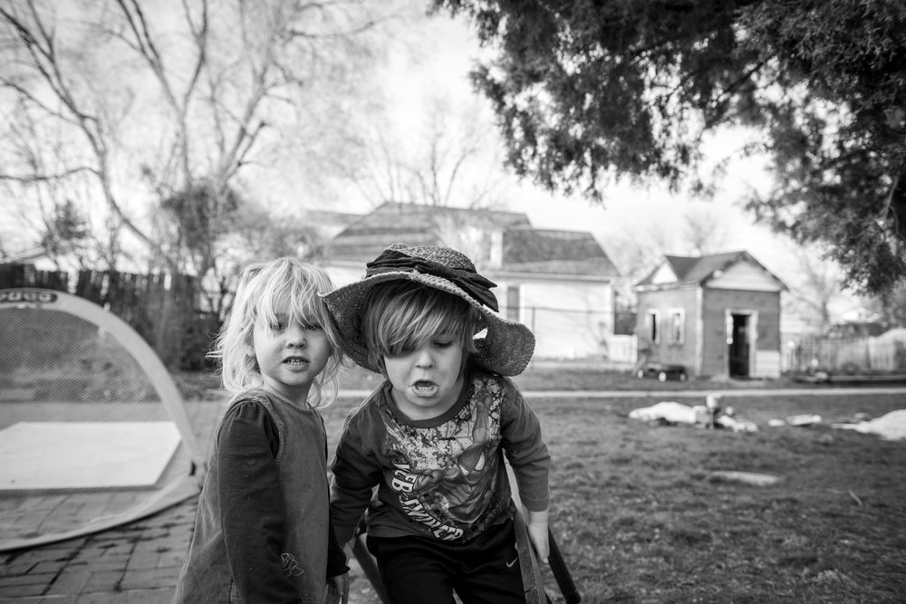 Blog - The Pen & Camera - Gratitude Journal, Inspirational, Siblings, Writing, Motherhood, Denver, Colorado -  Molly Rees Photo - Black and White Documentary Childhood Photography - children playing in yard by M. Menschel