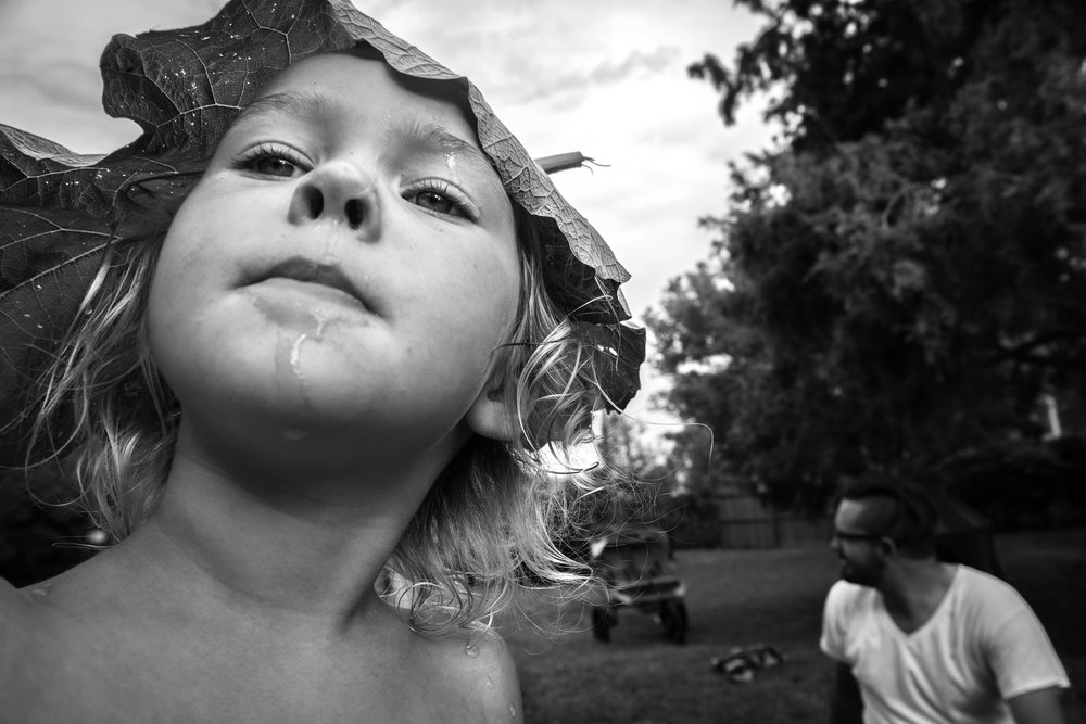 Blog - The Pen & Camera - Gratitude Journal, Inspirational, Spirituality, Motherhood, Writing, Denver, Colorado -  Molly Rees Photo - Black and White Documentary Childhood Photography - girl with leaf on head by M. Menschel
