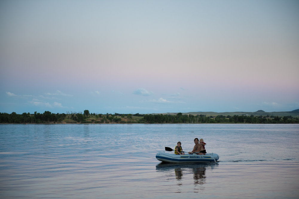 Blog - The Pen & Camera - Molly Rees Photo - Documentary Childhood Photography - children in raft at sunset at Chatfield Reservoir in Denver, Colorado by M. Menschel