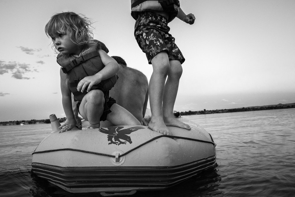 Blog - The Pen & Camera - Molly Rees Photo - Black and White Documentary Childhood Photography - children in raft at Chatfield Reservoir in Denver, Colorado by M. Menschel