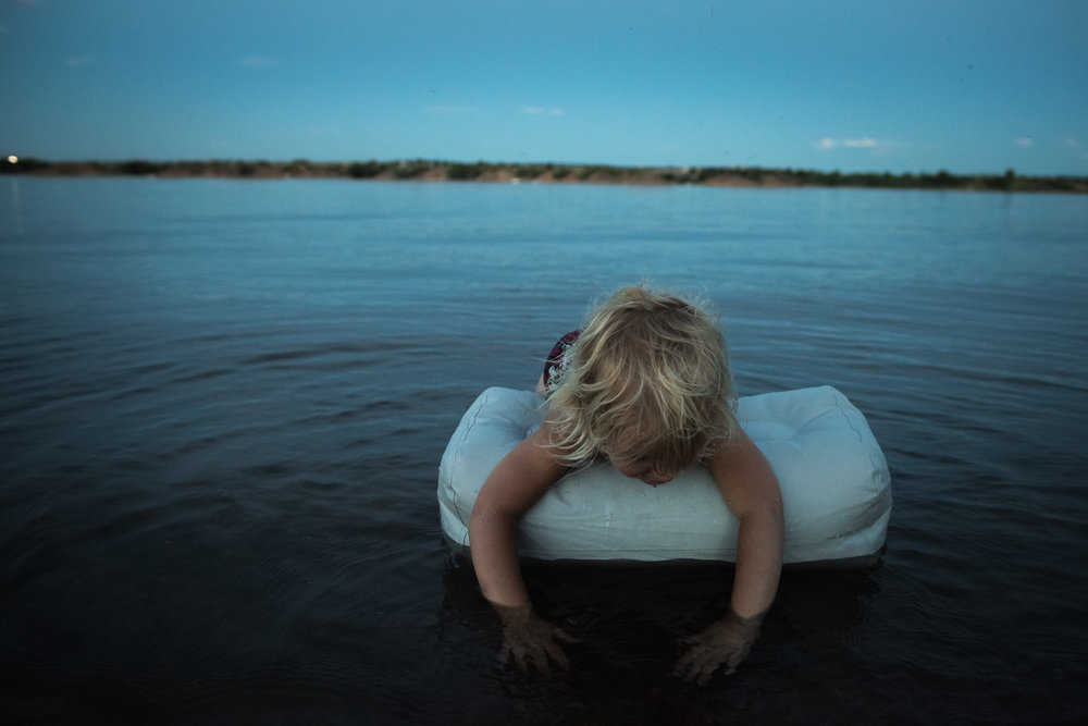 Blog - The Pen & Camera - Molly Rees Photo - Documentary Childhood Photography - girl at night in water at Chatfield Reservoir in Denver, Colorado by M. Menschel