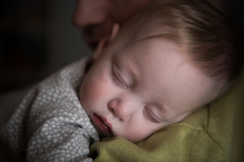 Documentary Family Photography in Denver, Colorado - father holding sleeping baby