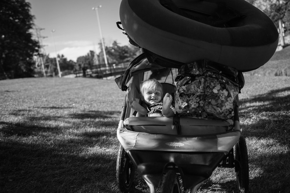 Blog - The Pen & Camera - Molly Rees Photo - Black and White Documentary Childhood Photography - boy in stroller with tube at Belleview Park in Denver, Colorado by M. Menschel