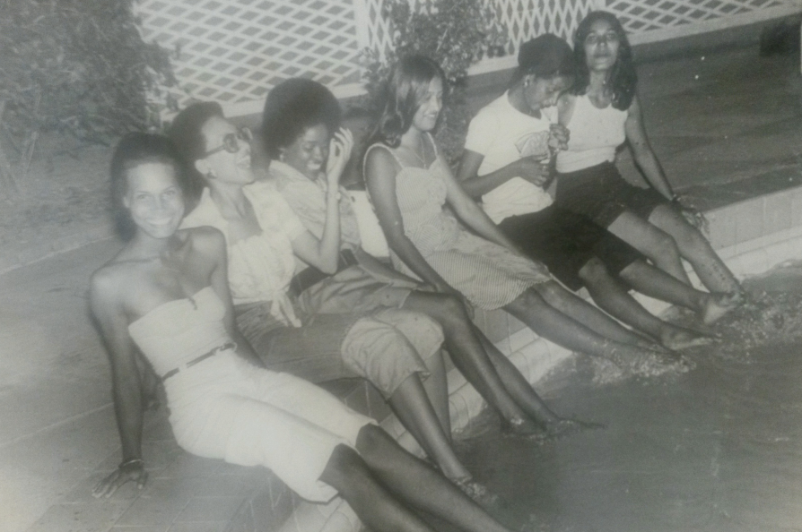 MOM (3RD IN GROUP) ON A PHOTOSHOOT WITH A GROUP OF MODELS AT THE PEGASUS  HOTEL IN GUYANA DURING THE 1970S