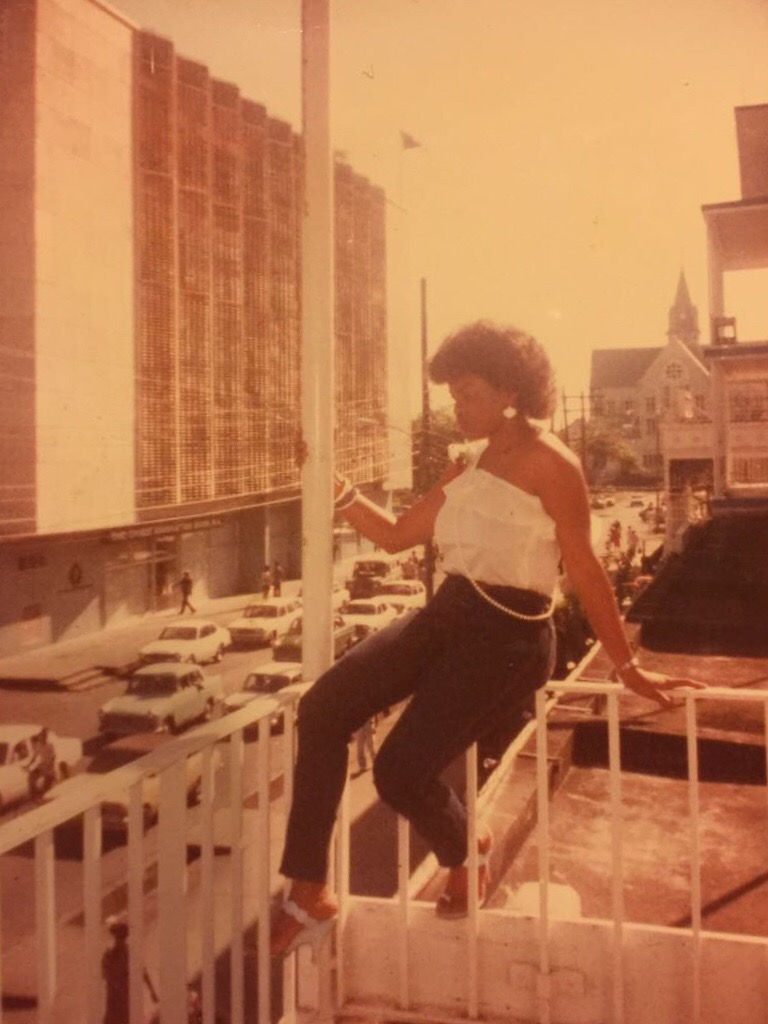 Mom sitting on the veranda of the Post Office in Guyana overlooking St. George's Cathedral as well as the Bank of Guyana.