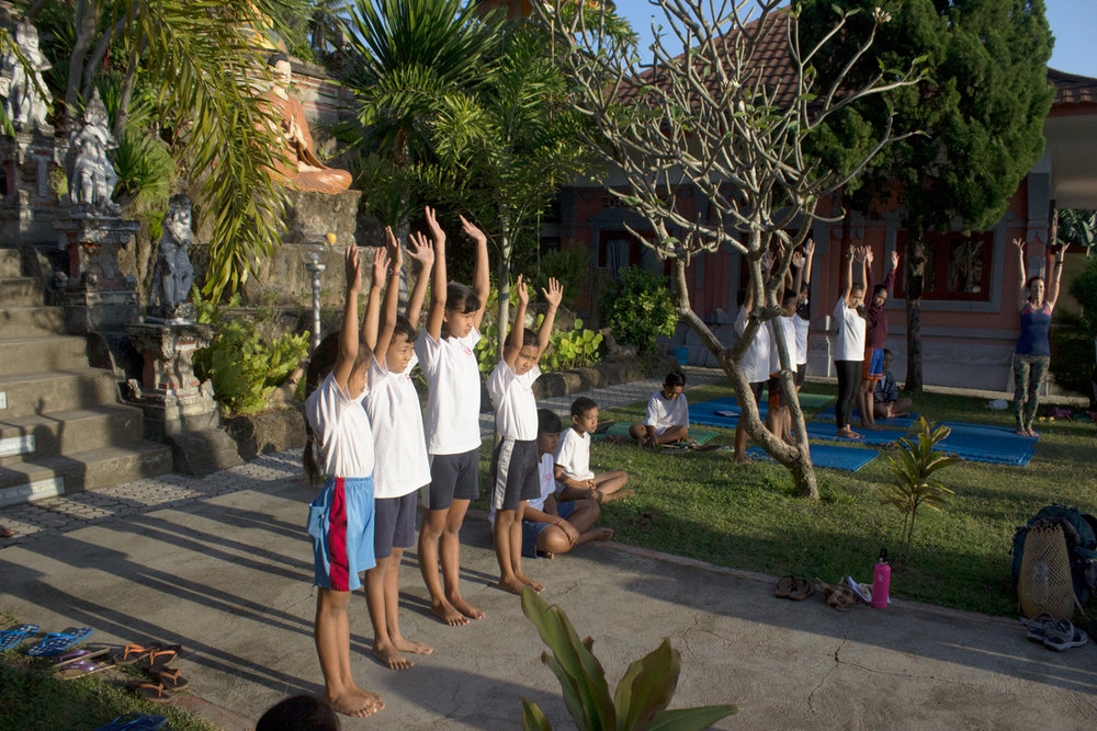 Bali Children Foundation youth practicing yoga at Let's Imagine Yoga Camp