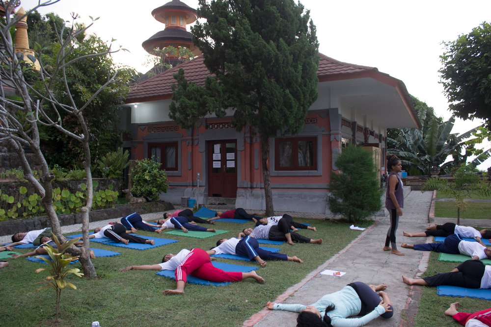 Supine Twist for cool down led by Volunteer Yoga Teacher Maggy
