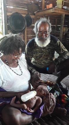 Evangelist Yusuf and his wife feeding little Marsasila new formula.