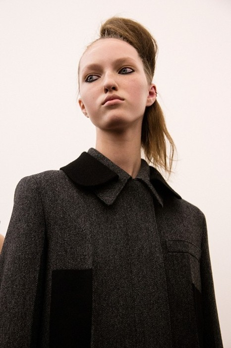 Liza Ostanina (Next) backstage at Prada AW15 menswear  Photography Virginia Arcaro