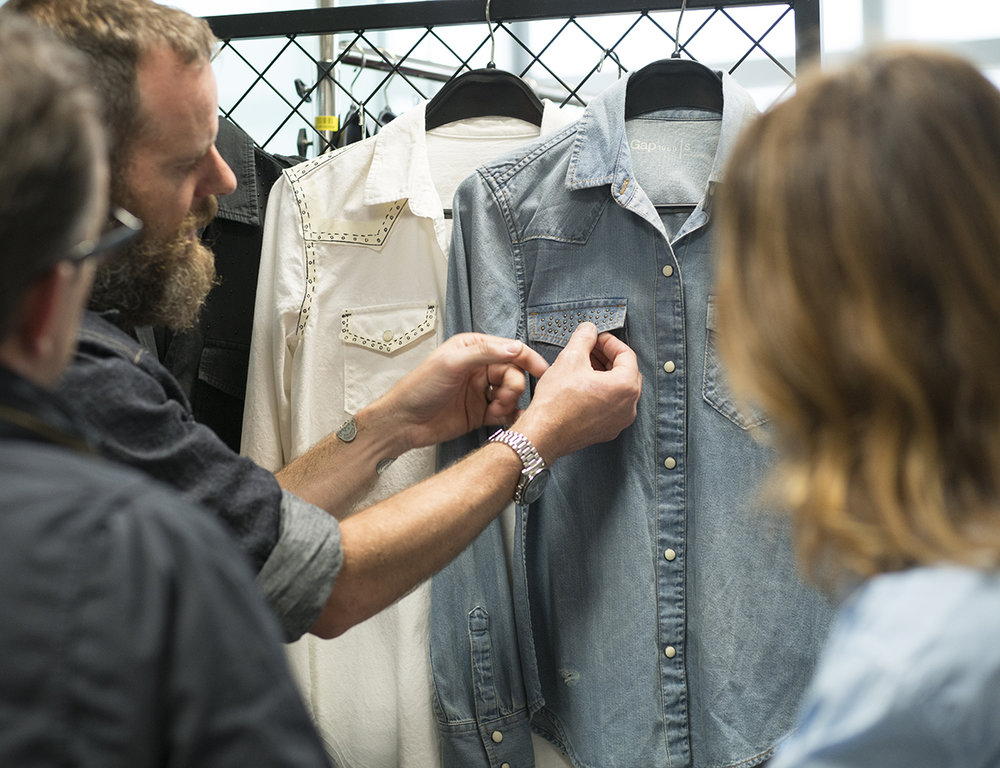Gap's design and merchandising teams pore over the details of a garment for Holiday.