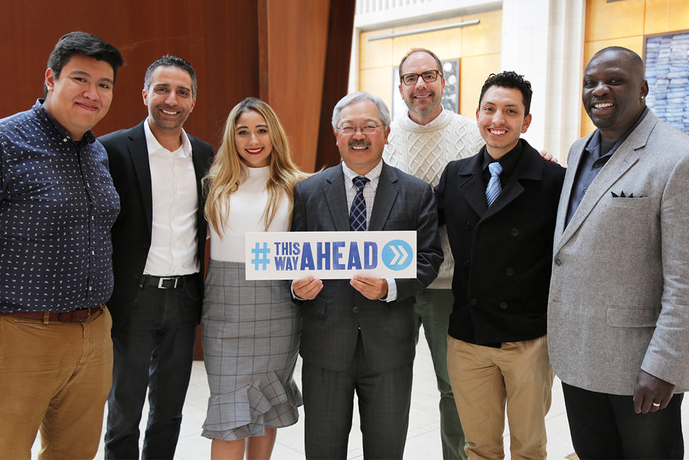 San Francisco Mayor Ed Lee poses with SVP of Global Sustainability and Gap Foundation President David Hayer, EVP of Talent & Sustainability Brent Hyder, SVP of Loss Prevention Keith White, and graduates of the This Way Ahead Internship program at San Francisco graduation event.