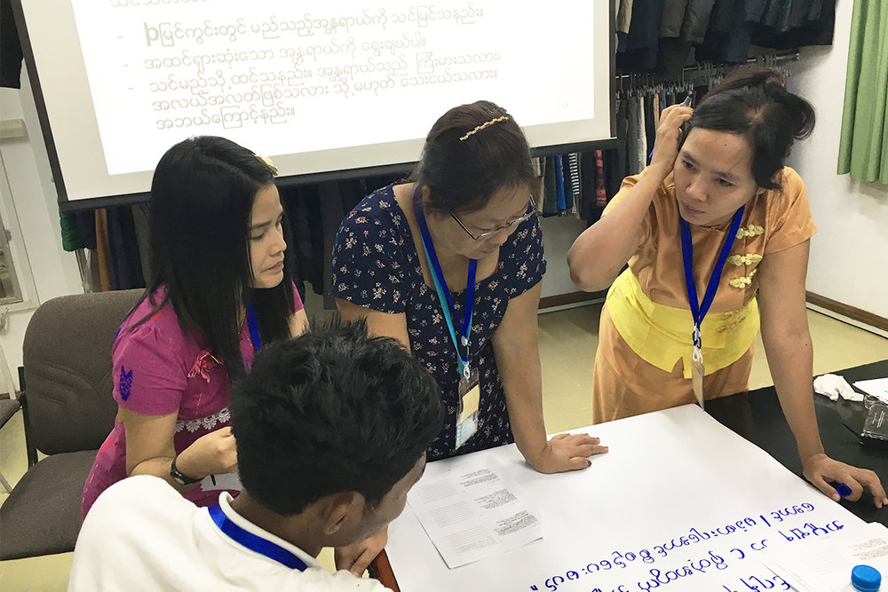 Worker-management committee representatives engage in a breakout activity during a training conducted by Gap Inc.