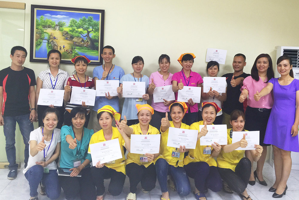 Members of the committee holding their certificate of completion for one of the trainings held near Hanoi, Vietnam.