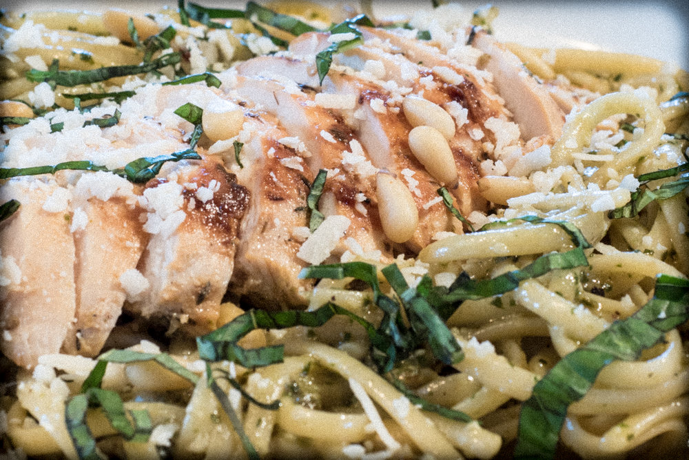 PESTO CHICKEN.  Sauteed chicken breast over linguine tossed in our basil pesto, then sprinkled with  parmesan, fresh basil, and toasted pine nuts.