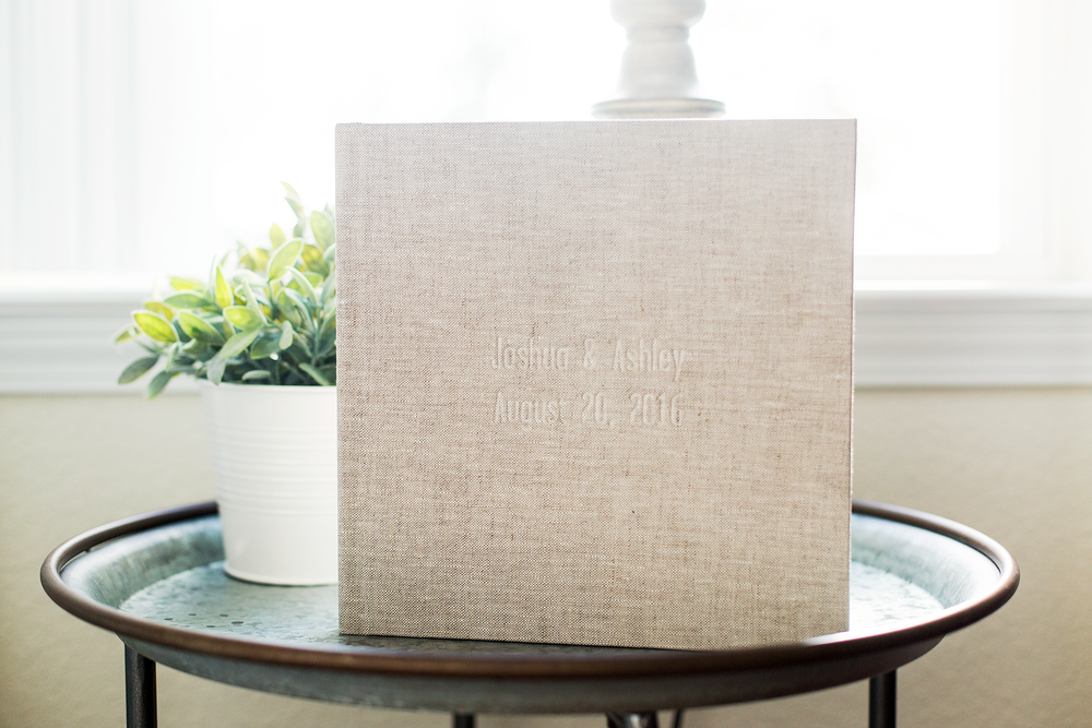Elegant blind debossing featuring the bride and groom's names and wedding date.