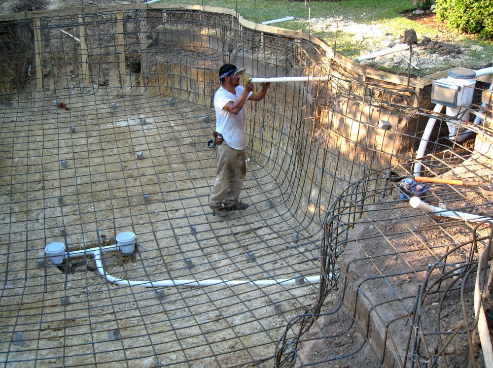Inground Pool Plumbing Installation : Construction — backyard amenities houston pool builder