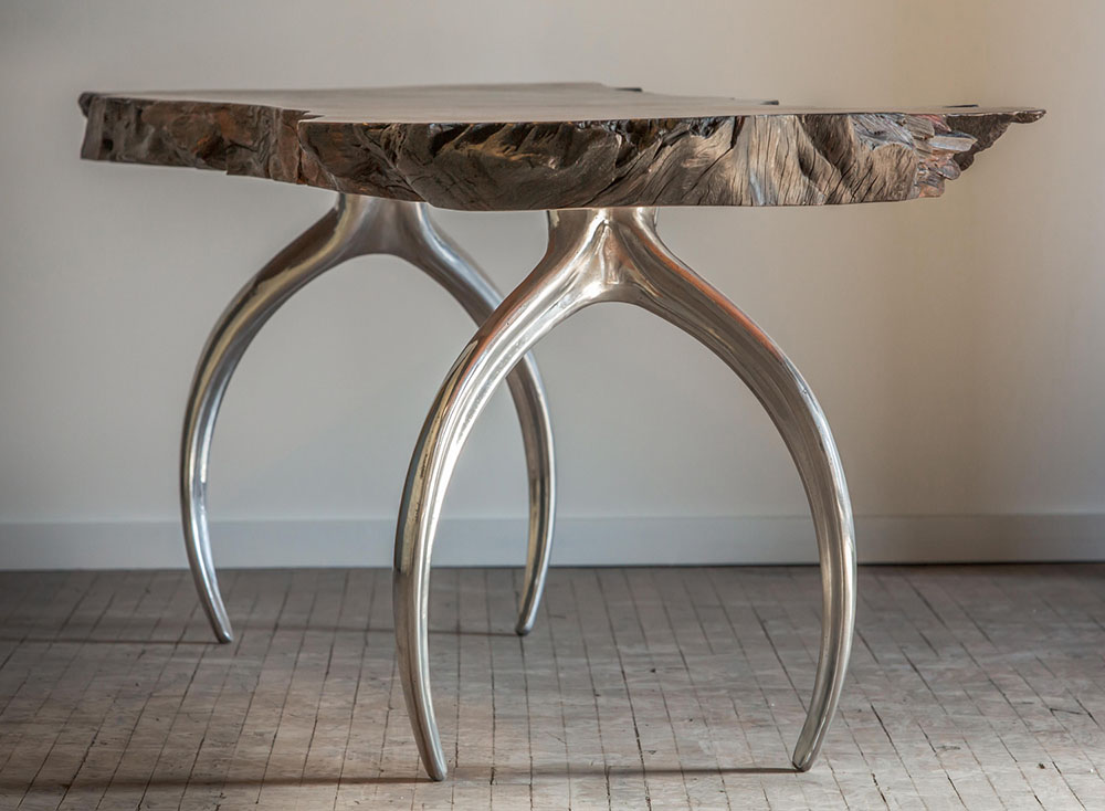 Mirror finish polished aluminum cast table legs paired with a wood dining table top.