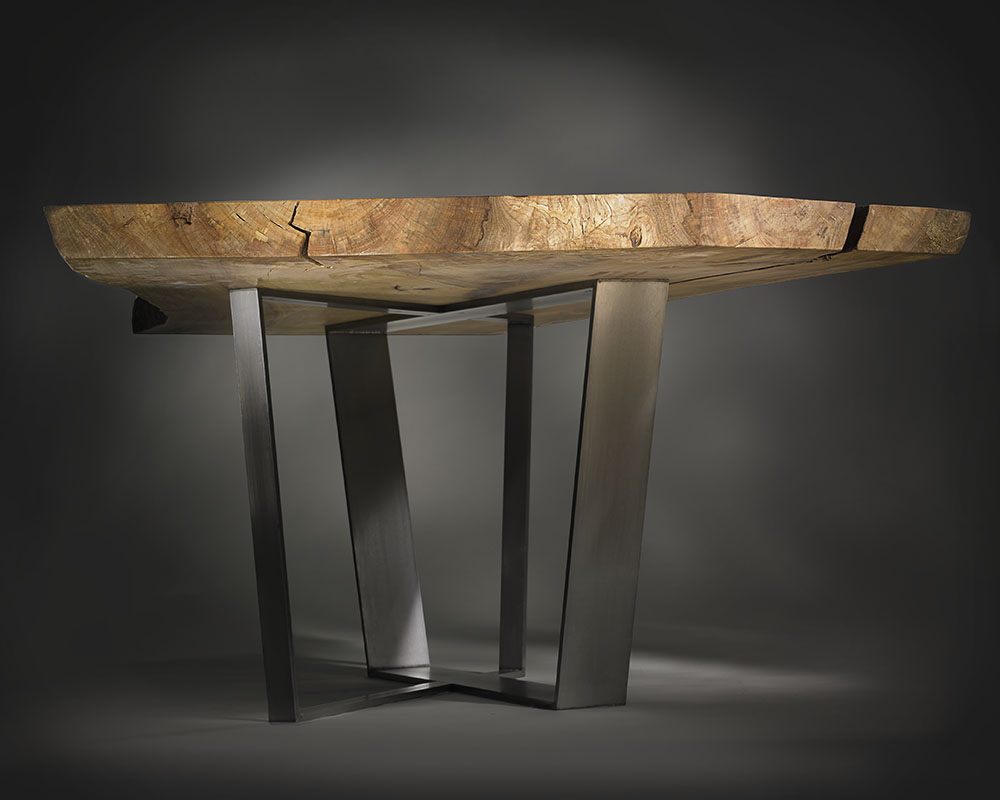 Custom wood table with metal legs; modern industrial.