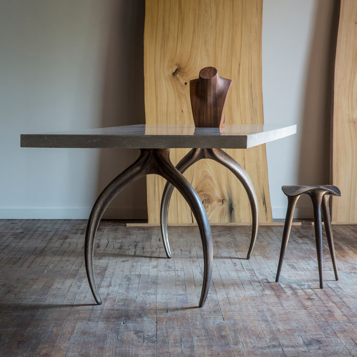Dining table shown with other STACKLAB products.