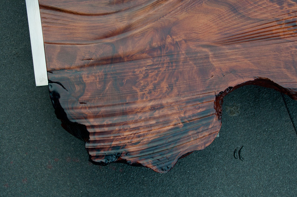 Detail of natural edge of redwood - custom design and fabrication of oyster platter.