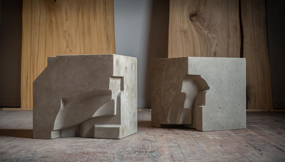 Cast cubes, used as furniture or sculptural objects; Engineered Cementitious Composite.