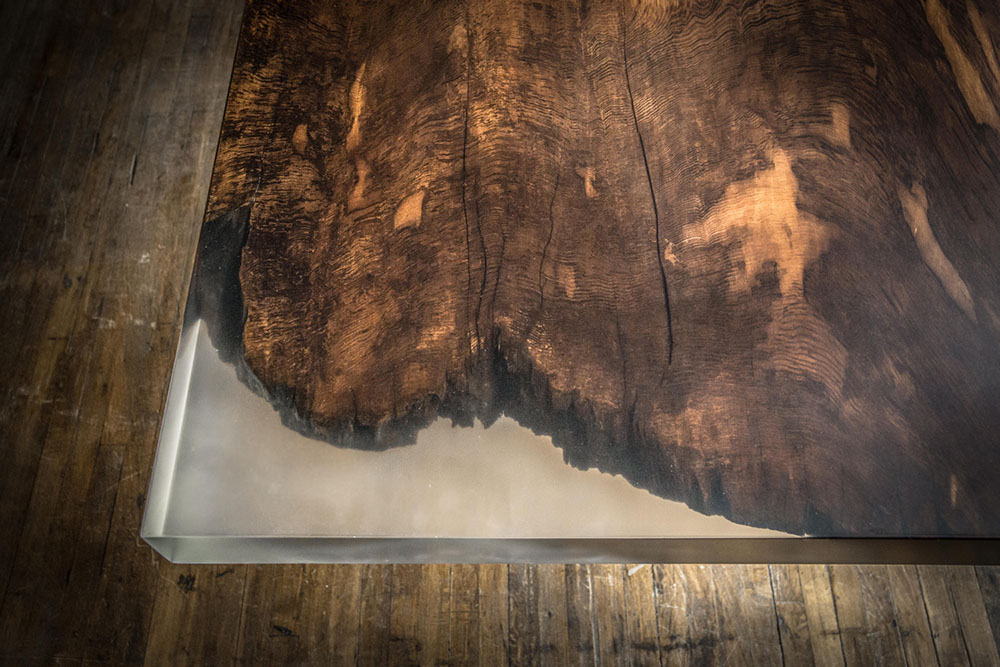 Detail of custom large redwood and resin dining table.