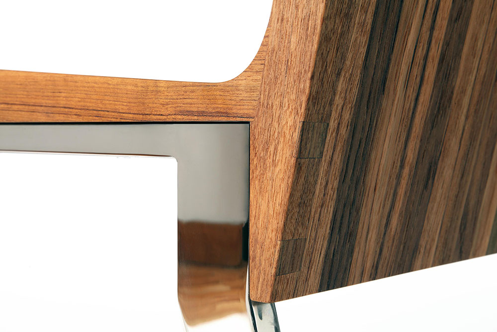 Detail showing join of wood and metal; custom occasional chair designed by STACKLAB and Arash Sadr.