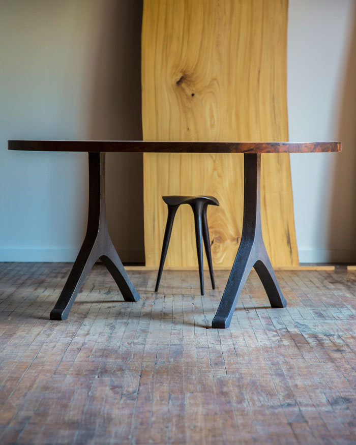 Custom beech dining table with cast iron legs.