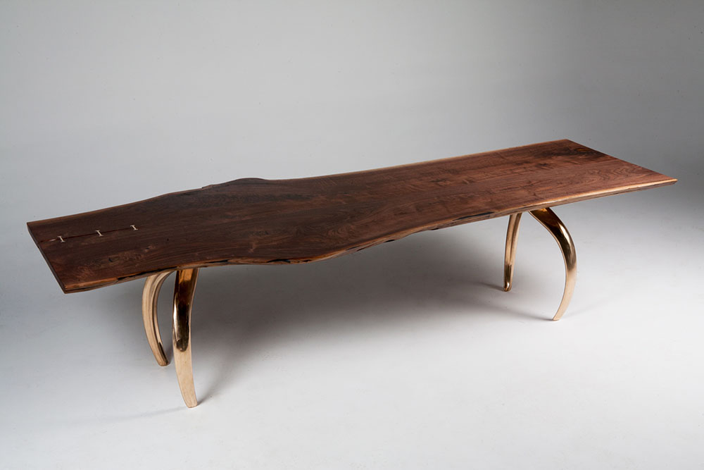 Custom extra-large dining table with a wood surface and metal legs.
