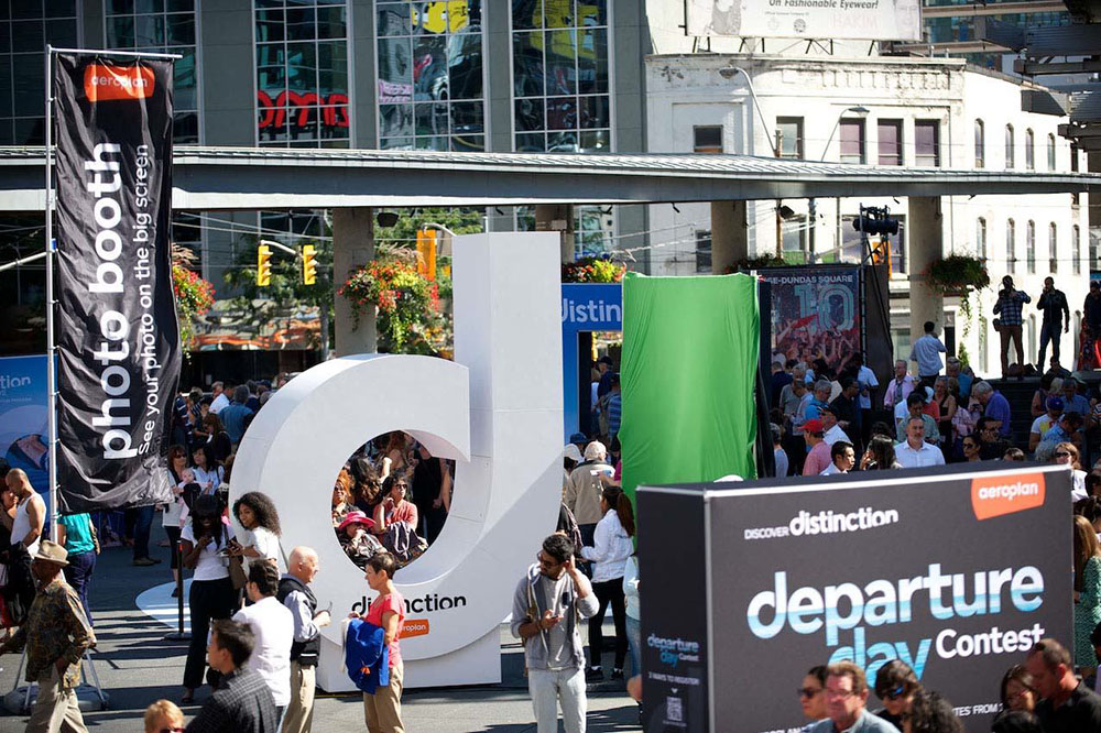 Interactive advertising installation shaped like letter D in the crowded Yonge-Dundas Square in downtown Toronto.