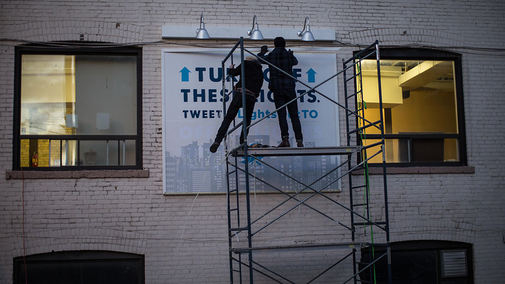 Installation of Twitter-activated interactive advertising billboard.