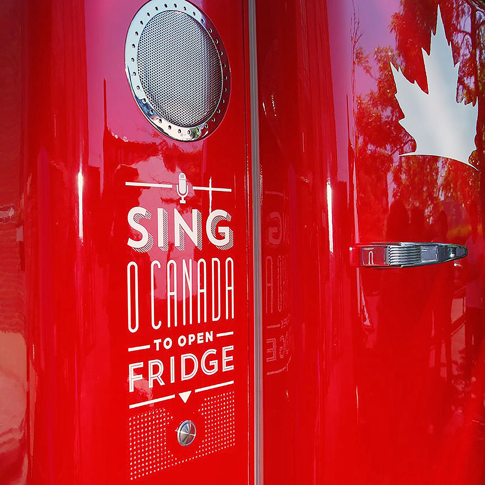 "Detail of red Molson Anthem Fridge: ""Sing O Canada to open fridge""."