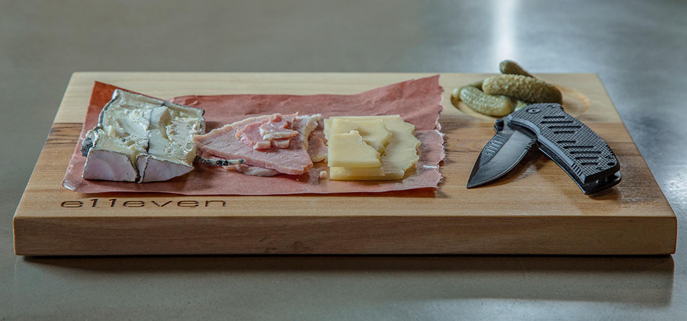 Laser-engraved charcuterie board, custom made in Toronto, Canada.