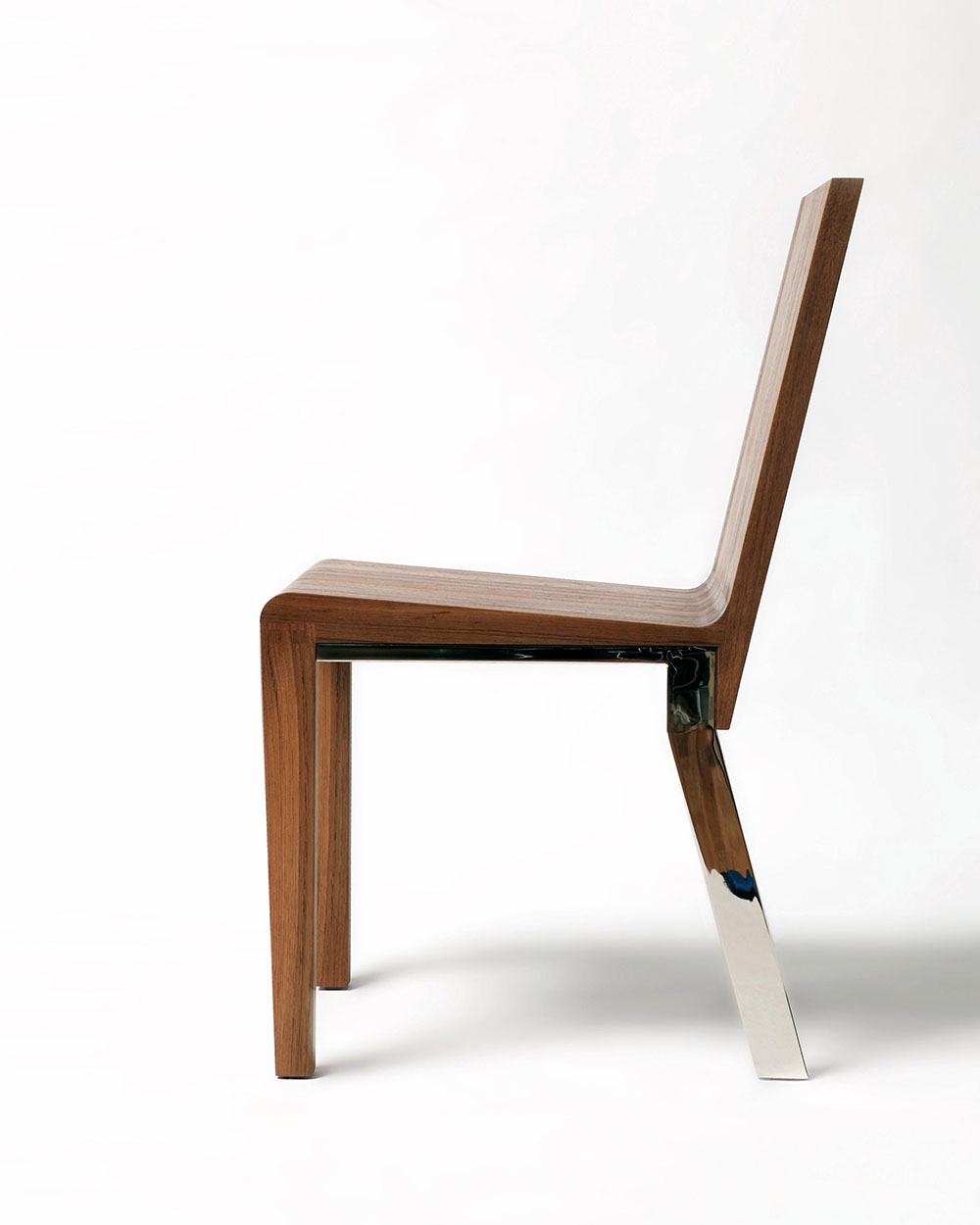 Side view of custom occasional chair, shown on white background.